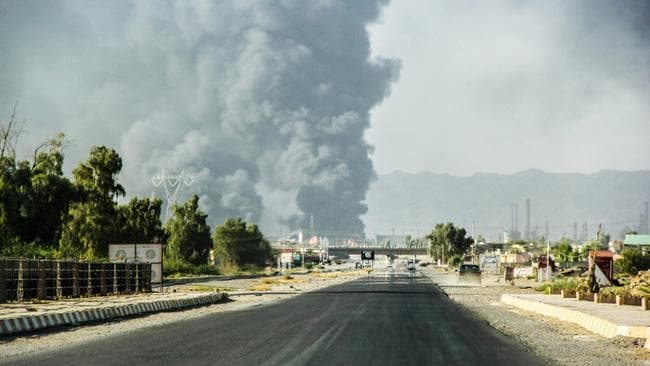 A column of smoke rises from an oil refinery in Beiji, some 250 kilometres of Baghdad, Iraq, after an attack by Islamic militants. Picture: AP