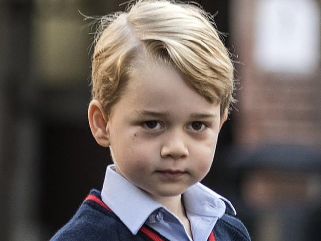 Britain's Prince George arrives for his first day of school at Thomas's school in Battersea, southwest London. Picture: Richard Pohle/AFP