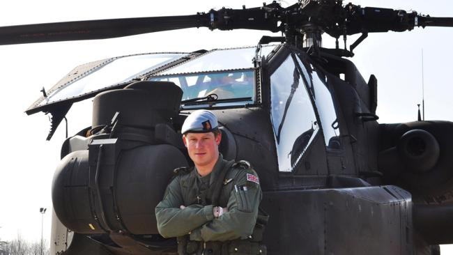 Prince Harry stands in front of an Apache Helicopter a few days after the royal, a trainee Apache helicopter pilot, passed the half-decade milestone to become a captain.