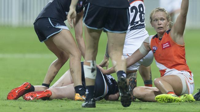 Bri Davey lies on the turf after suffering what appears to be a serious leg injury.