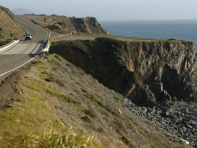 A truck drives by the pullout where the SUV of Jennifer and Sarah Hart was recovered off the Pacific Coast Highway, near Westport, California. Picture: AP