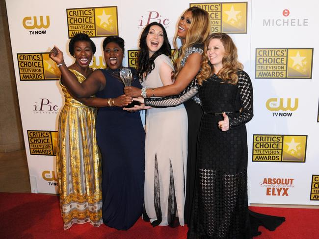"Stars ... from left, Uzo Aduba, Danielle Brooks, Laura Prepon, Laverne Cox, and Natasha Lyonne pose with the award for best comedy series for ""Orange is the New Black"" in the press room at the Critics' Choice Television Awards."