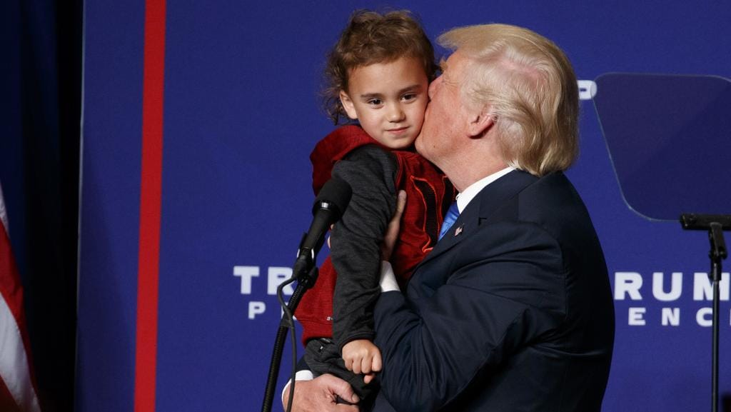 Trump was kissing kids on the campaign trail this week, and it's all a bit weird when you think about it. Picture: Evan Vucci/AP