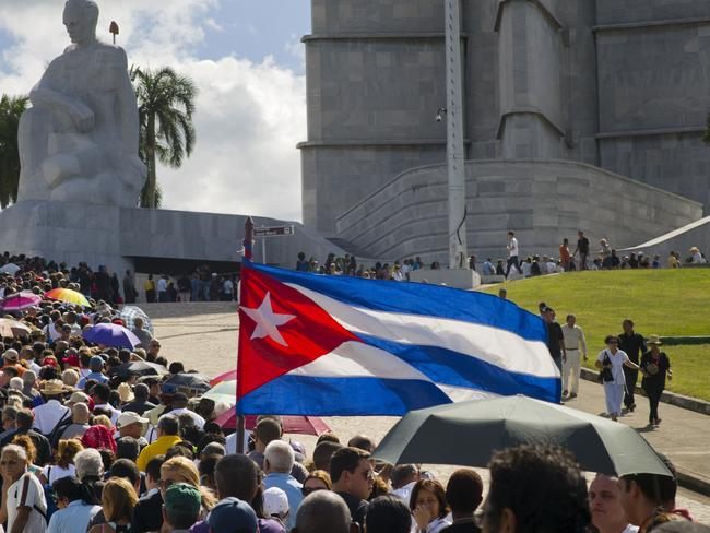 People wait in line to pay their final respects to the late Fidel Castro, at Revolution Plaza, the site of two days of tributes to the legendary leader, in Havana, Cuba. Picture: Ramon Espinosa/AP