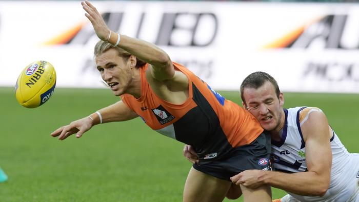 Nick Haynes of the giants tackled by Michael Apeness of the dockers during the round 22 AFL match between the Greater Western Sydney (GWS) Giants and the Fremantle Dockers at Spotless Stadium in Sydney, Saturday, August 20, 2016. (AAP Image/Brendan Esposito) NO ARCHIVING, EDITORIAL USE ONLY