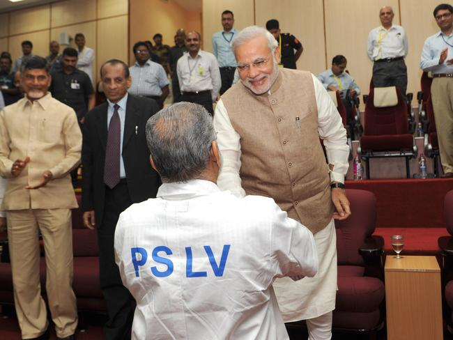 Success ... Indian Prime Minister Narendra Modi (R) congratulates ISRO Chairman Dr. K Radhakrishnan following the successful launch of the Polar Satellite Launch Vehicle on June 30. Picture: AFP/PIB