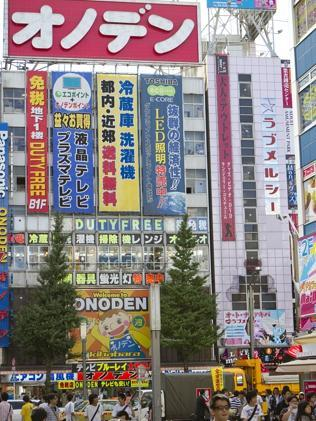 Shoppers in Akihabara (Electric Town), shopping district specializing in manga comics and electronics.