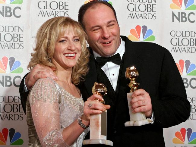 Critically acclaimed ... Actors Edie Falco, left, and James Gandolfini with their awards for best performance by an actor and actor in a dramatic television series for The Sopranos in 2000.
