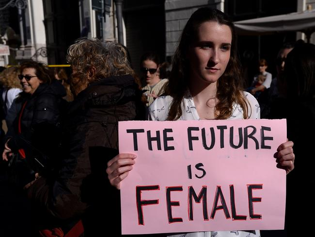 """A woman holds a banner reading """"The future is female"""" during Rome Resists demonstration part of the Women's March in downtown Rome. Picture: AFP"""