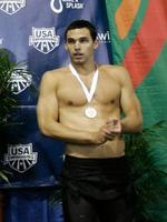 <p>Ricky Berens stand on the podium following the men's final 100-meter freestyle event during the USA Swimming Grand Prix Series.</p>
