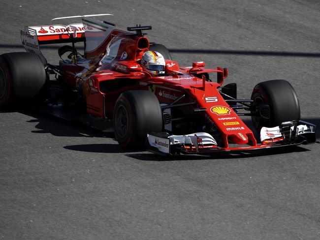 Vettel leads Ferrari lockout for Russian GP