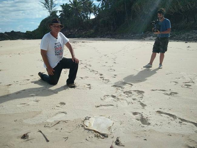 Blaine Alan Gibson with the latest piece of possible MH370 debris found on Riake Beach, Madagascar. Picture: Facebook