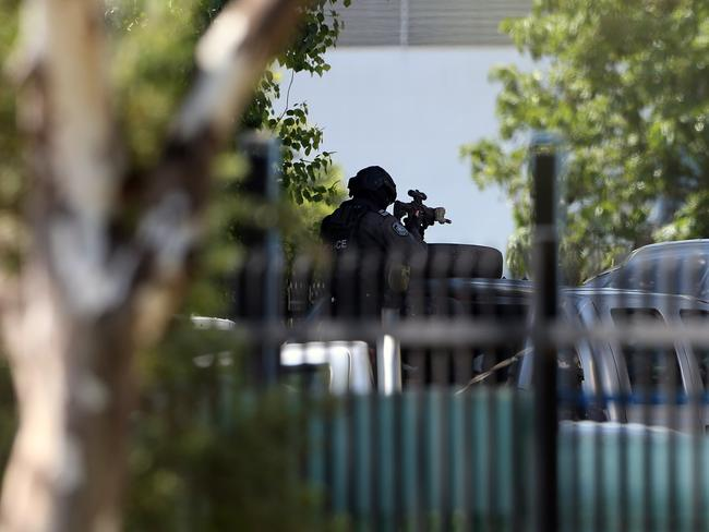 A tactical police officer close to the scene at in Ingleburn. Picture: Richard Dobson