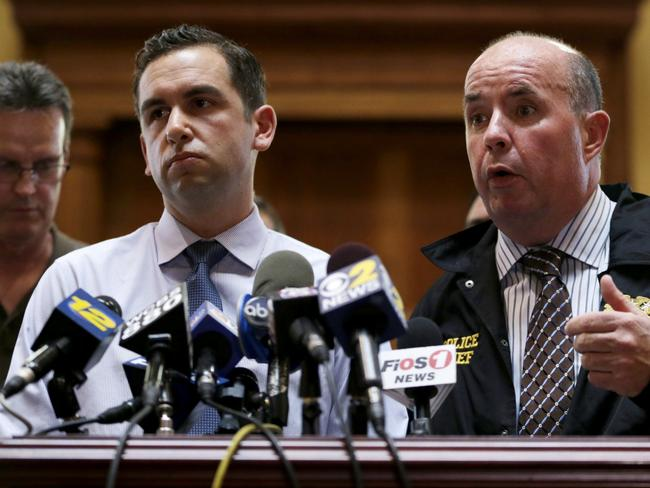 Disgusted ... Jersey City Police Chief Robert Cowan, right, talks while standing next to New Jersey Mayor Steven Fulop.