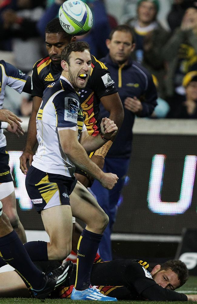 Nic White celebrates his try for the Brumbies.