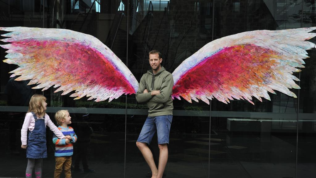 Steve Fisher tries out the Wings with his children Caitlin, 6, and Kai, 3. Photo: Justin Benson-Cooper