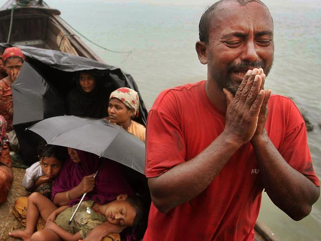 A Rohingya man who fled Myanmar to Bangladesh to escape religious violence cries as he pleads from a boat after he and others were intercepted by Bangladesh border authorities last year. Picture: AP