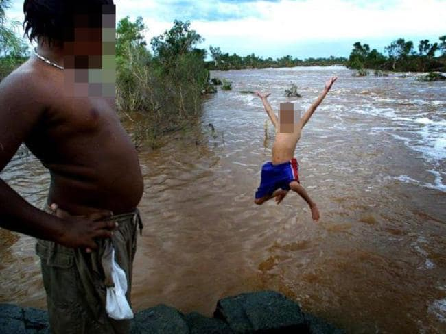Kids playing after local floods in Roebourne, Western Australia which has a 'atggering' rate of child sex abuse. Picture: Andy Tyndall.