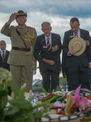 D-day veteran Stuart (Snow) and Harold Davis (centre), pay respects after laying a wreath in Paris. Picture: Alastair Miller