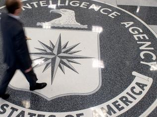 A man crosses the Central Intelligence Agency (CIA) logo in the lobby of CIA Headquarters in Langley, Virginia, on August 14, 2008. AFP PHOTO/SAUL LOEB / AFP PHOTO / SAUL LOEB