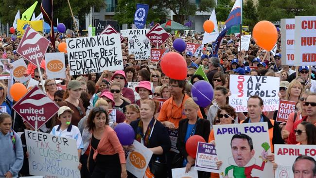 Thousands of teachers and parents join a strike protesting educatin cuts by the Barnett G