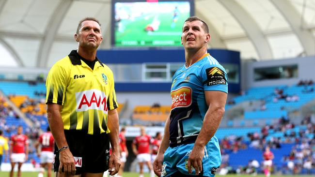 Referee Shane Hayne talks with Greg Bird