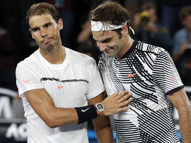 Switzerland's Roger Federer, right, is congratulated by Spain's Rafael Nadal.