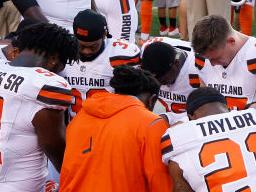 CLEVELAND, OH - AUGUST 21: A group of Cleveland Browns players kneel in a circle in protest during the national anthem prior to a preseason game against the New York Giants at FirstEnergy Stadium on August 21, 2017 in Cleveland, Ohio. (Photo by Joe Robbins/Getty Images)