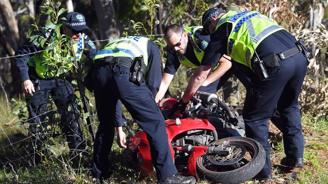 Police at the scene, with motorcycle involved in the fatal crash on Piggott Range Road in Clarendon. Picture: Tom Huntley