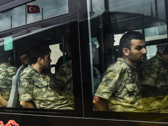 Detained Turkish soldiers who allegedly took part in a military coup arrive in a bus at the courthouse in Istanbul last week. Picture: Bulent Kilic