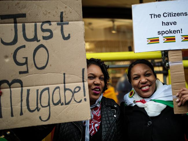 Protesters demonstrate outside the Embassy of Zimbabwe in London to call on the leader of the country Robert Mugabe to resign. Picture: Jack Taylor/Getty Images