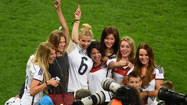 Partners of German squad members pose after Germany won the 2014 FIFA World Cup.