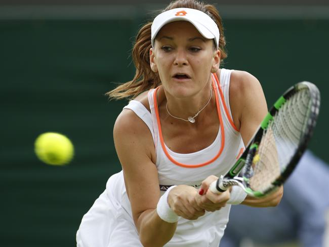 Agnieszka Radwanska of Poland plays a return to Andreea Mitu of Romania.