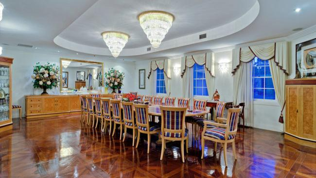 1 Palm Ave, Ascot features Italian chandeliers and an oversized dining room for extravagant entertaining.