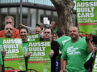Monday rally ... Holden workers protested outside Liberal Party headquarters in Melbourne on Monday. Photos: Kris Reichl
