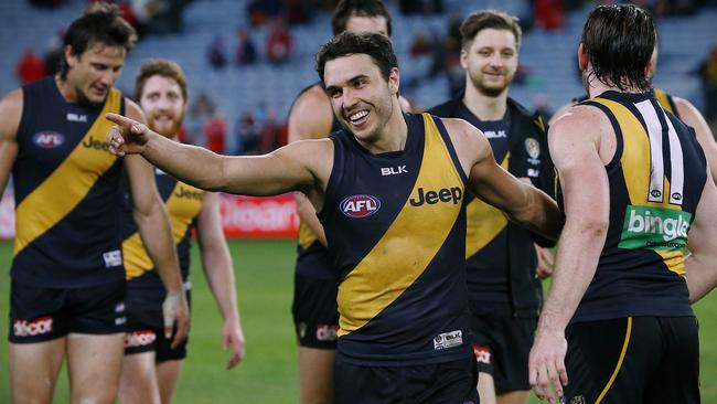 Tiger players celebrate the win over Sydney. Picture: Wayne Ludbey