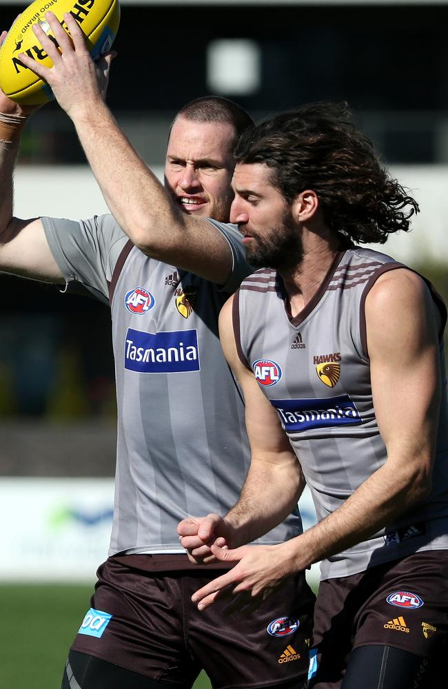 Jarryd Roughead of the Hawks marks during an AFL Hawthorn Football Club training session at Waverley Park on Friday 22nd August, 2014. Picture: Mark Dadswell
