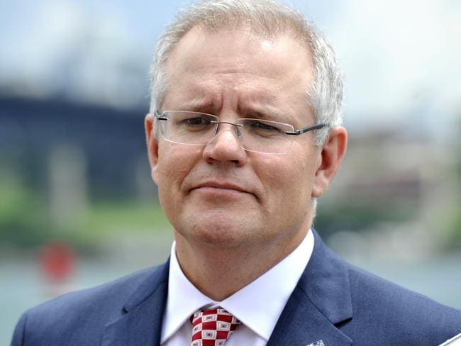 Federal Treasurer Scott Morrison wants to tax digital products bough overseas to make it fairer for Aussie businesses. Picture: AAP/Joel Carrett