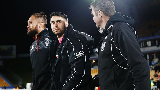 Shaun Johnson watches on from the sideline after injuring his knee.