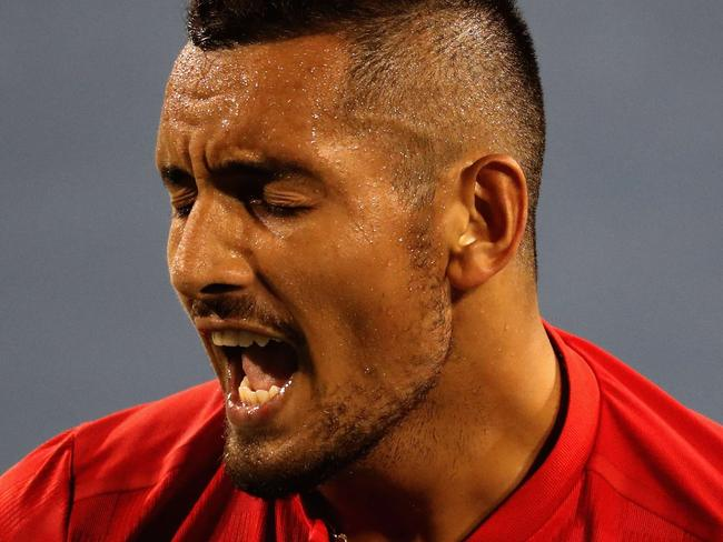 MASON, OH - AUGUST 19: Nick Kyrgios of Australia reacts to a shot against David Ferrer of Spain during Day 8 of the Western and Southern Open at the Linder Family Tennis Center on August 19, 2017 in Mason, Ohio.   Rob Carr/Getty Images/AFP == FOR NEWSPAPERS, INTERNET, TELCOS & TELEVISION USE ONLY ==