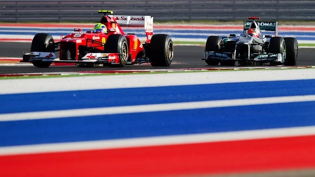Brazil's Felipe Massa of Scuderia Ferrari takes turn 16 followed by Germany's Michael Schumacher of Team Mercedes at the US Formula One Grand Prix in Austin, Texas.