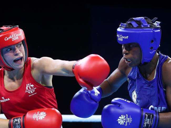 Christelle Aurore Ndiang of Cameroon, right, fought Australia's Skye Nicolson in the Women's 57kg Quarterfinal Boxing on the Gold Coast before she vanished. Picture: Chris Hyde/Getty Images