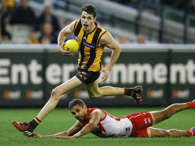 Isaac Smith slips the Leroy Jetta tackle and goals. Picture: Michael Klein