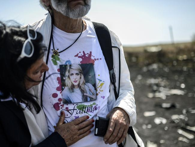 Tragic scene ... Angela Rudhart-Dyczynski and Jerzy Dyczynsk from Australia react as they arrive at the crash site of the Malaysia Airlines Flight MH17 to look for their late 25 years old daughter Fatima.