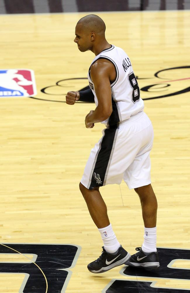 Patty Mills reacts after sinking a three for the San Antonio Spurs.