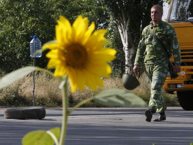 Cease fire ... A pro-Russian fighter walks at a check-point near the city of Kramatorsk, Donetsk region.