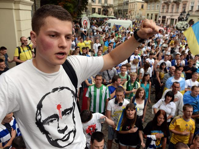 A nation enraged ... a young Ukrainian football supporter makes his point clear in a rally in the Ukrainian city of Lviv. Picture: Yurko Dyachyshyn