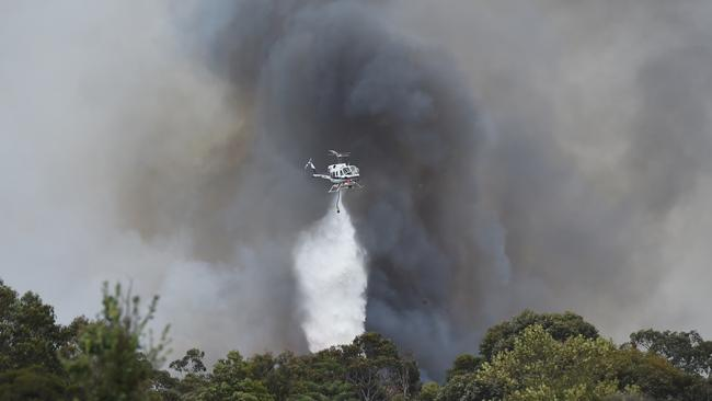 A fast moving grass fire now threatening houses at Somerville on the Mornington Peninsula. Picture: Chris Eastman