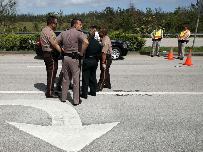 Law enforcement officers huddle at a checkpoint where they are preventing people from returing to their homes in the Florida Keys. Picture: AFP/Getty