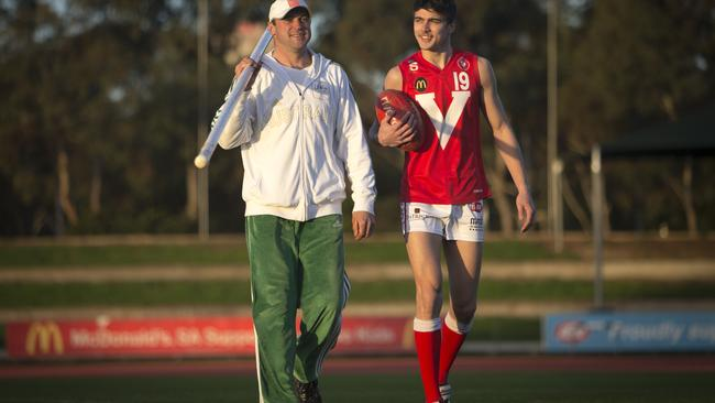 Former pole vault champion Dmitri Markov with his son Oleg, an up and coming young footballer.